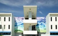 Photo of Public Artwork, colorful wave mural on the front of the Amman Building.