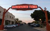 Downtown Yuma sign lit at twilight