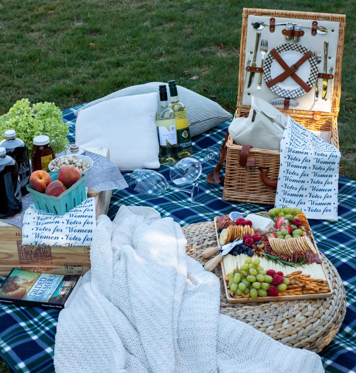 Picnic Blanket With Food, Peaches And Wine Glasses