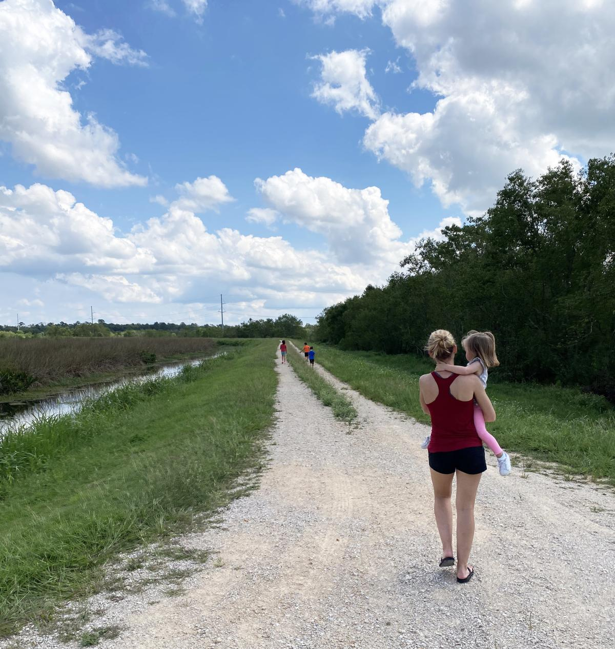 Woman and children in Cattail Marsh in Beaumont, TX