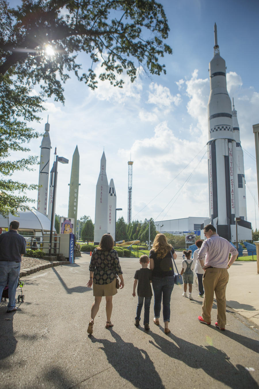 Visitors stand in awe of the outdoor exhibit at the US Space and Rocket Center in Huntsville.