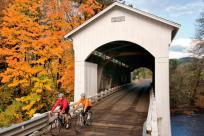 Mosby Covered Bridge Cycling in Fall by David Bassett