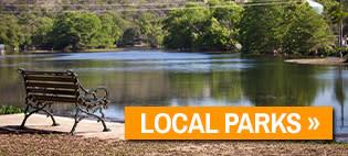 An empty park bench overlooking Landa Lake.