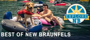"A young man and a labrador retriever float down the Comal River in New Braunfels, Texas. The dog and his owner are each sitting in an inflatable tube. The photo is accompanied by the ""Explore NB"" logo."
