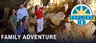 A family of four and a tour guide explore an underground cave at Natural Bridge Caverns, located just outside New Braunfels, Texas.