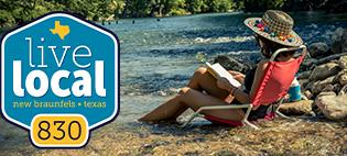 The Live Local logo appears alongside a photo of a young woman reading a book while sitting in a beach chair in the shallows of the Guadalupe River.