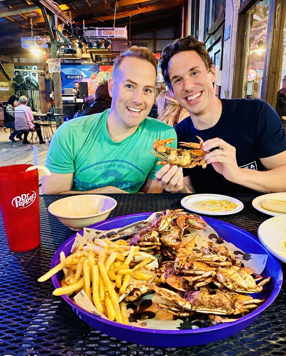 Friends enjoy a seafood platter at Beaumont's Crazy Cajun restaurant.