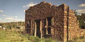 A broken down brick house in the ghost town of Chloride, NM