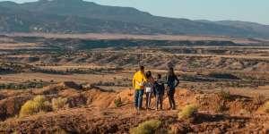 A family enjoys the vista in Rio Arriba county