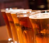 close up of golden beer in glasses