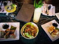 Sense of Thai dishes on table in Loudoun County, VA