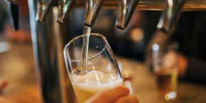 Image of a beer being poured at a bar