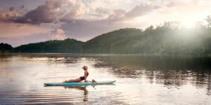 Upward dog yoga pose during SUP Yoga at the Chattahoochee River