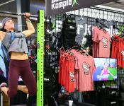 Doing pullups inside a pop-up shop at the CrossFit Games