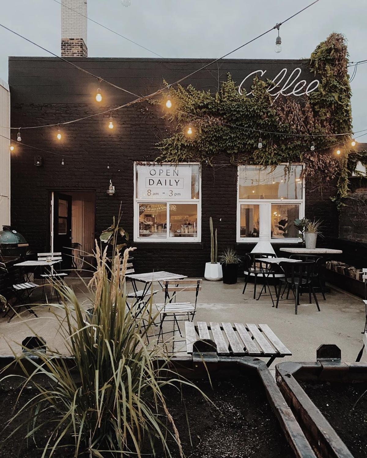 Outdoor patio seating at Harless + Hugh Coffee in Bay City