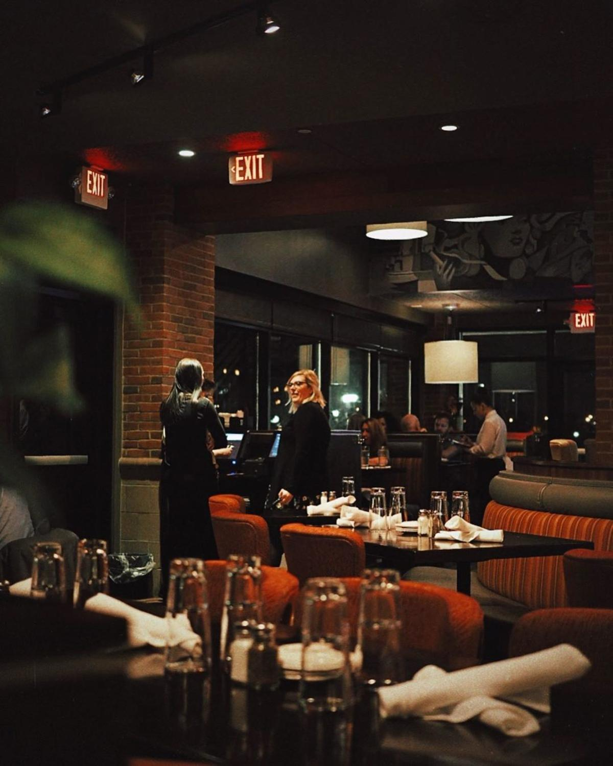Warm, inviting, dimly lit dining room at Real Seafood Company in Bay City