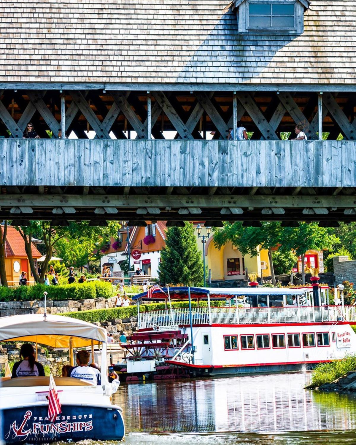 Bavarian Belle Riverboat and Frankenmuth FunShips passing under the Holz-Brucke Covered Bridge in Frankenmuth