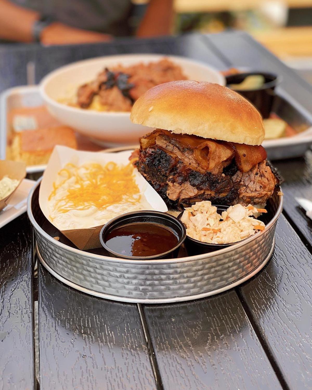 The Three Amigos: pork, brisket, and smoked bacon piled high on a soft bun at Molasses Smokehouse + Bar in Midland