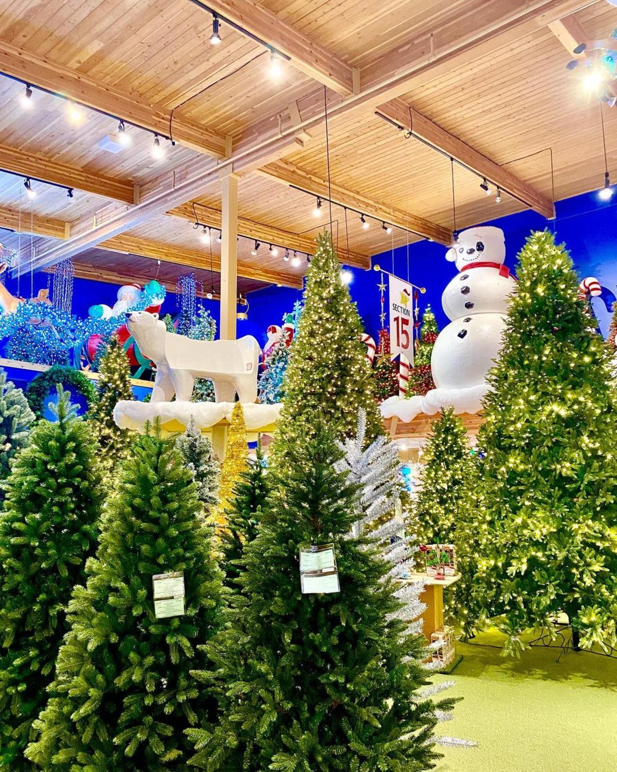 Christmas trees and other holiday decorations in the brightly-lit showroom at Bronner's CHRISTmas Wonderland in Frankenmuth