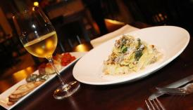 Appetizer, wine, and entree at The Perfect Caper