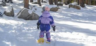 Small child Snowshoeing