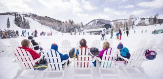 Family sitting at Ski Beach at Deer Valley Resort
