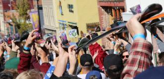 Crowd lift shot skis in the air