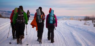 Yoga participants hiking in snow