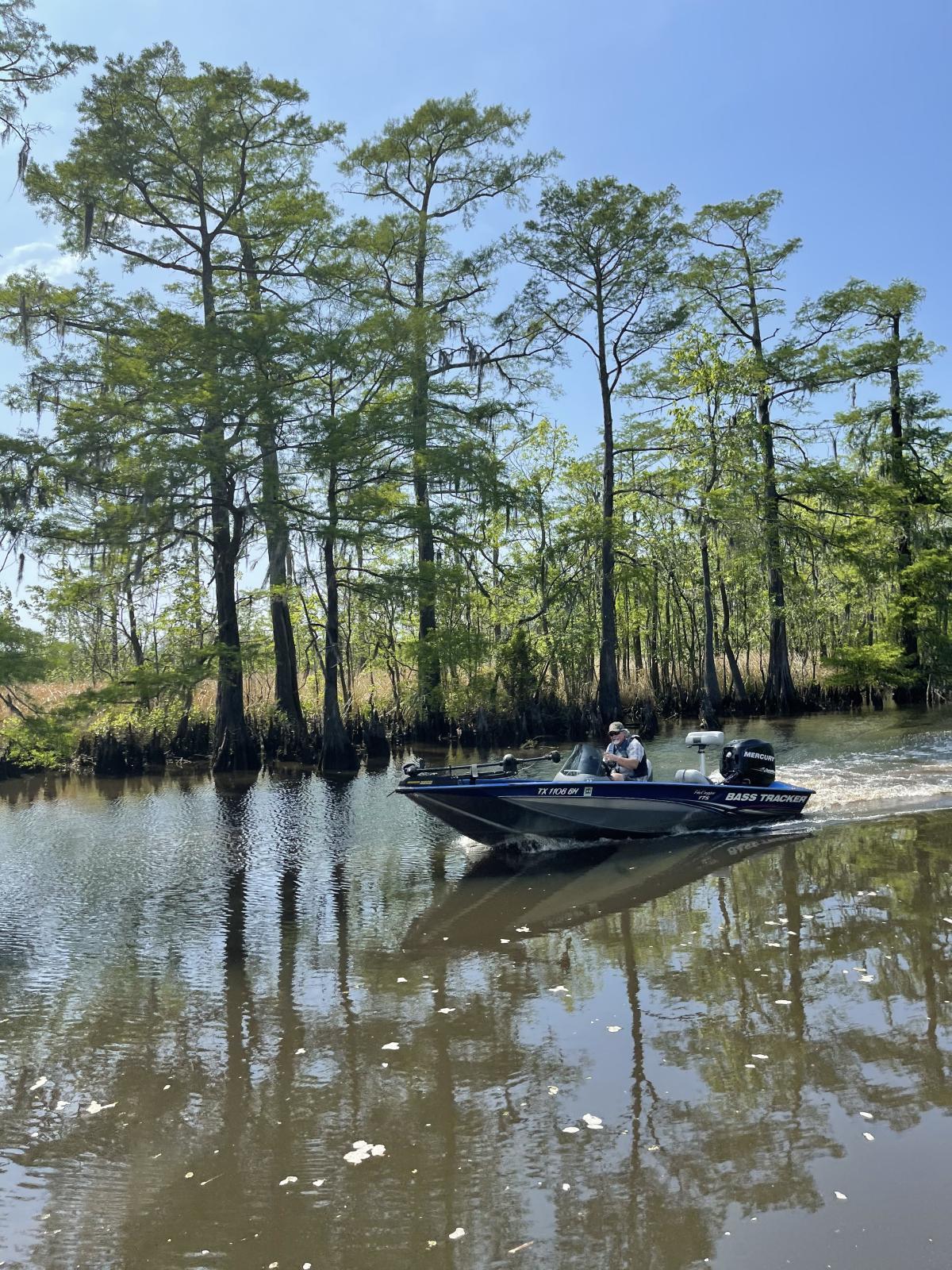 Man on speedboat in swamp in Beaumont, TX