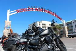 World's Most Famous Beach sign with motorcycles