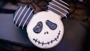 Image of Mickey-shaped cookie with Jack Skellington decorated on top.