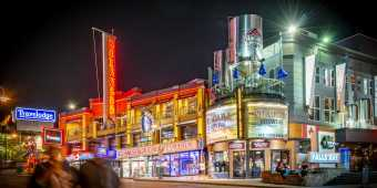 The bars, museums and shops of Niagara's Clifton Hill at night
