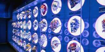 A wall of hockey helmets at the Hockey Hall of Fame