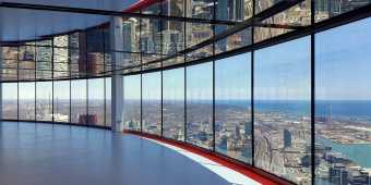 Floor to ceiling windows at the CN Tower showing the Toronto city skyline