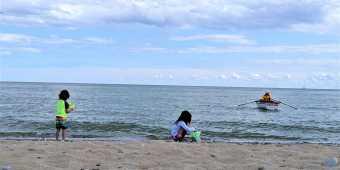 Children on the sand at Woodbine Beach in Toronto