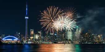Fireworks explode off the CN Tower at night