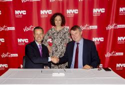 NYC & Company signs a brand new city-to-city tourism partnership with visitBerlin during an event at the German Consulate General New York. Pictured (L-R): Fred Dixon, NYC & Company President and CEO; Ramona Pop, Deputy Mayor / Senator for Economics, Energy and Public Enterprises of Berlin; Burkhard Kieker, CEO of visitBerlin. Photo Credit: Brittany Petronella/NYC & Company.