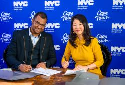 Enver Duminy, CEO, Cape Town Tourism (left) and Makiko Matsuda Healy, Managing Director, Tourism Market Development, NYC & Company (right) sign the Cape Town Tourism and NYC & Company City-to-City Tourism Partnership Renewal on August 26, 2019.Photographer credit: Johann Botha, iPhoto SA