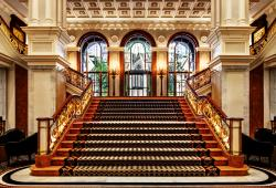 Lotte-New-York-Palace_Lobby-Staircase-facing-Courtyard_Courtesy