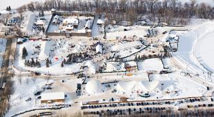 Aerial photo of Voyageur Park showing the tents and grounds of Festival du Voyageur