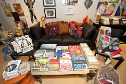 Books, games, artwork and a seating area in a Providence RI store