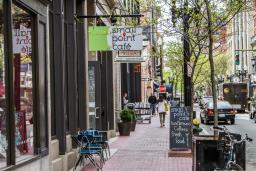 Shoppers stroll past popular boutiques on Westminster Street in Providence
