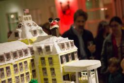 Ocean House Gingerbread village display with on-lookers in the background