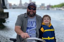 Father and son boat tour