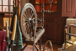 Rustic Interior With Cabinets, Chairs And Spinning Wheel At Stephen Hopkins House