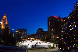 View of Providence, Rhode Island during the holidays with ice rink and tree lights