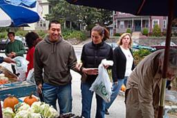 Customers Inspecting Vegetables in Goddard Park Market in Providence RI