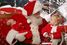 Santa with two children on his lap