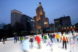 People Ice Skating outdoors in Providence RI at dusk