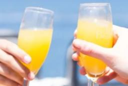 Friends toast their mimosas during a fun weekend out in Providence RI